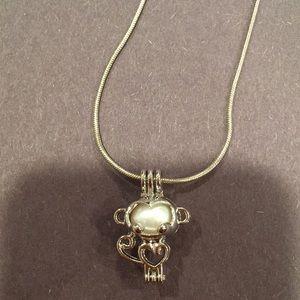 Monkey pearl pendant
